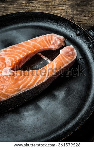 Fresh salmon with herbs and spices - healthy food, diet and cooking concept