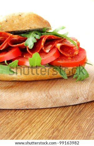 Fresh sandwich with chorizo and tomatoes