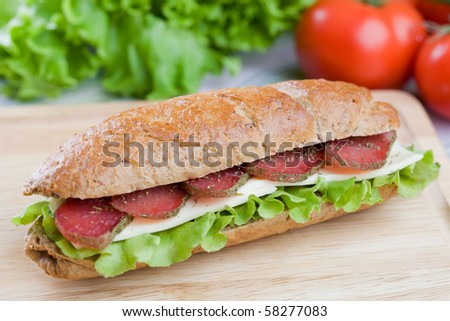 Fresh sandwich with dry meat and cheese on dietetic bread