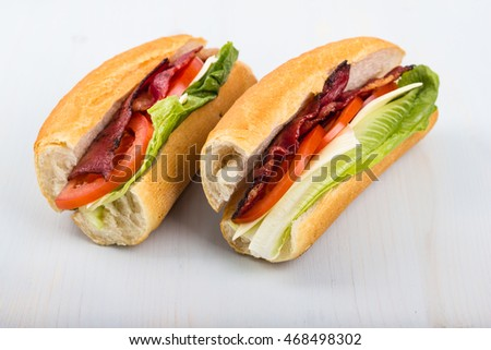 Fresh sandwich with tomatoes, bacon, and lettuce.