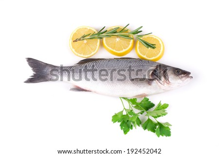 Fresh seabass with lemon on plate. Isolated on a white background.