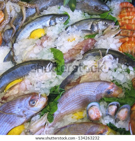Fresh seafood on ice at the fish - stock photo