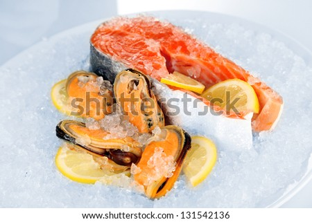 Fresh seafood on ice in plane isolated on white - stock photo