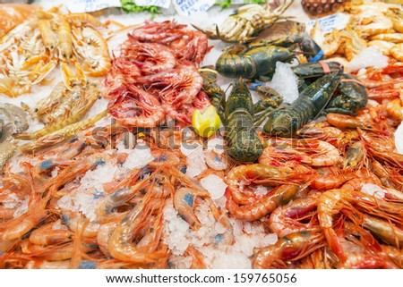 Fresh seafood on ice. Shrimp, crayfish, clams and lobster/Seafood variety - stock photo