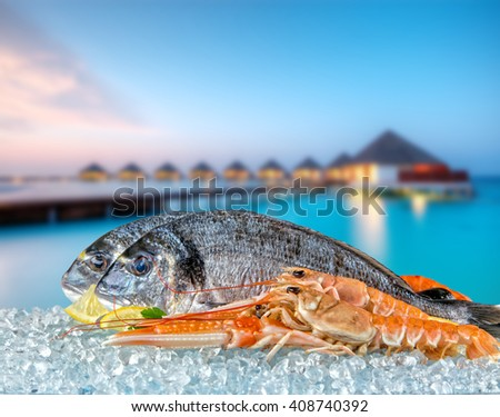 Fresh seafood with tropical resort villas - stock photo