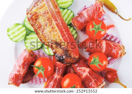 fresh served roasted meat chunk and rolls on white platter - stock photo