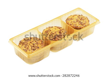 fresh sesame cookies in plastic pack, isolated on white - stock photo