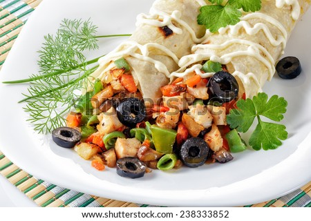 Fresh shawarma with chicken and vegetables on a white plate