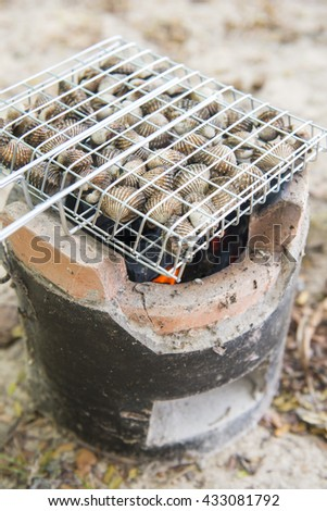 fresh shellfish on charcoal grill, seafood