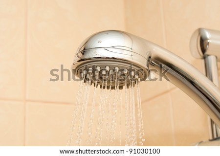Fresh shower in bathroom - stock photo