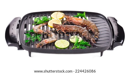 Fresh shrimps on a grill. Isolated on a white background.