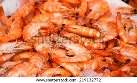 Fresh shrimps on the stall outside fish store in Paris (France). - stock photo