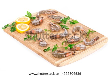 Fresh shrimps on wooden board. Isolated on a white background.