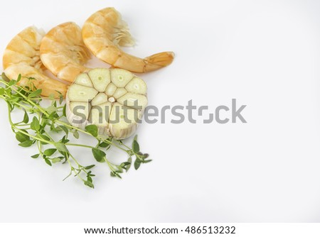 fresh shrimps tails with garlics and fresh thyme on white background