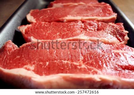 Fresh Sirloin Steaks In Tray (beef, meat, steak)  - stock photo
