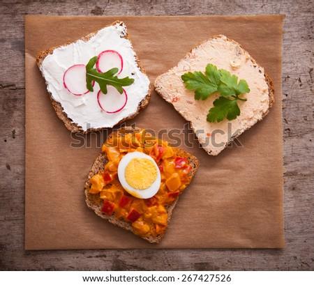 Fresh slice bread with vegetarian spread - stock photo