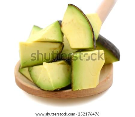 fresh sliced avocado on wooden spoon - stock photo