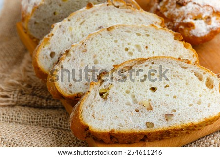 Fresh sliced bread with walnuts  - stock photo
