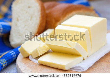Fresh sliced butter on the wooden table - stock photo