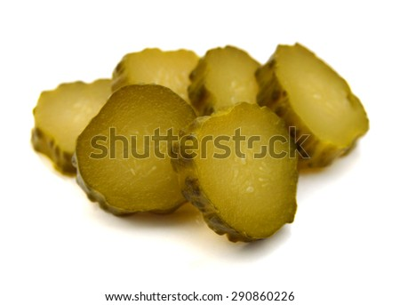 Fresh sliced green pickles isolated over white  - stock photo