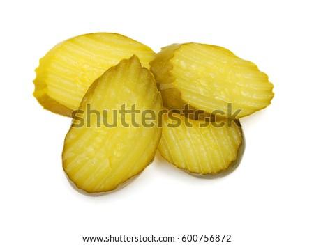 Fresh sliced green pickles isolated over white