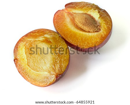 Fresh sliced plum isilolated on white background. Closeup - stock photo