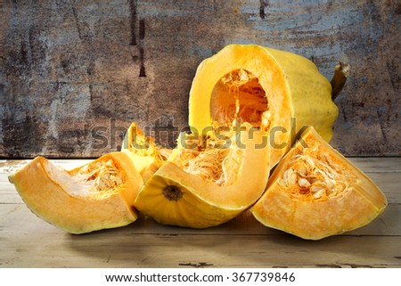 Fresh sliced pumpkin on wooden table