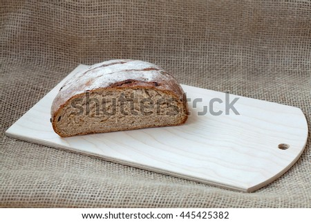 Fresh sliced rye bread on a sacking background, copyspace - stock photo