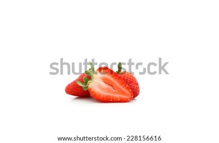 Fresh sliced strawberries isolated over a white background. - stock photo