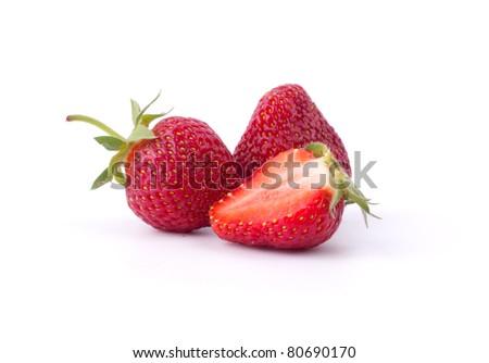Fresh sliced strawberries on white - stock photo