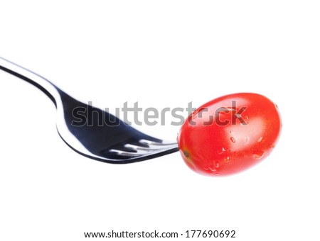 fresh small tomato on fork