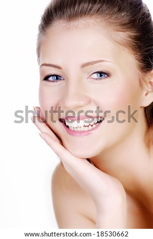 Fresh smiling woman face with hand at cheek - stock photo