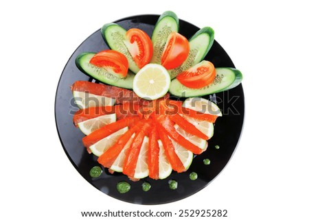 fresh smoked salmon served on black plate - stock photo