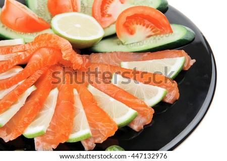 fresh smoked salmon served on black plate - stock photo