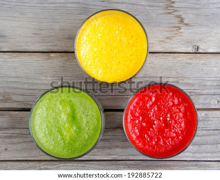 Fresh smoothies in the glass - green, red and yellow paprika - stock photo