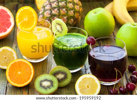Fresh smoothies with different fruits - stock photo