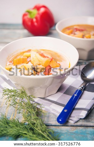 fresh soup with mussels,parsley and pepper - stock photo