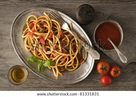 Fresh spaghetti with tomato sauce on a plate close up