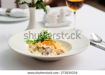 Fresh Spaghetti with Tomatoes and Walnuts - stock photo