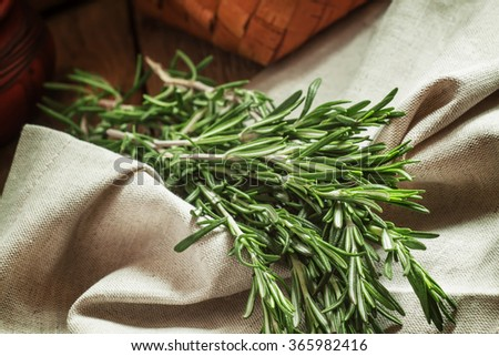 Fresh spicy fragrant rosemary on a gray napkin in rustic style, selective focus