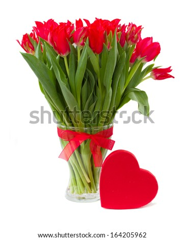 fresh spring red tulips in vase with heart present box isolated on white background - stock photo