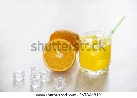 Fresh squeezed juice with fruits on the table