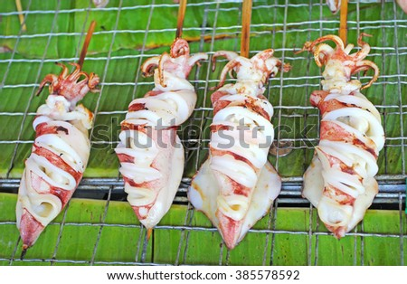 Fresh squid barbecue grilled, street food in Bangkok, Thailand - stock photo