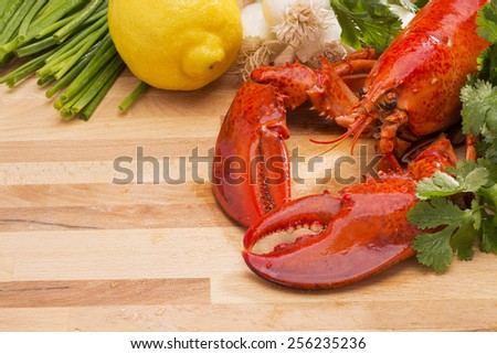 Fresh Steamed Lobster with Lemon and Fresh Vegetables - stock photo