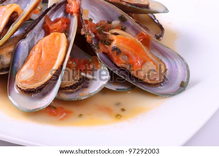 Fresh steamed mussels with sauce - stock photo