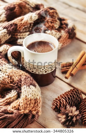 Fresh steaming cup of coffee/cocoa on a winter morning (selective focus) - stock photo