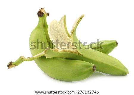 fresh still unripe  bananas and a peeled one on a white background - stock photo
