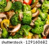 Fresh stir-fried vegetables (broccoli, zucchini, peppers, mushrooms) - stock photo