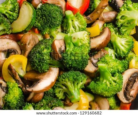 Fresh stir-fried vegetables (broccoli, zucchini, peppers, mushrooms) - stock photo