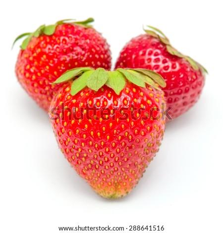 Fresh strawberries closeup isolated on white background - stock photo
